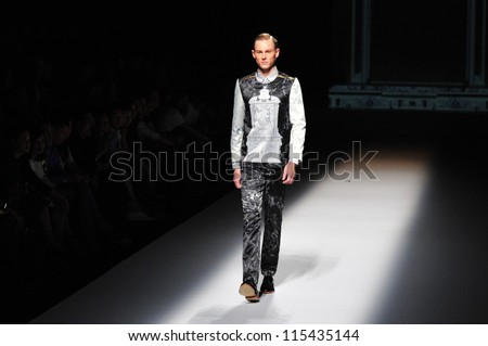 "BANGKOK, THAILAND - OCT 12 : Model walks the runway at "" Painkiller"" collection presentation during ELLE Fashion Week 2012 on October 12, 2012 in Bangkok Thailand."