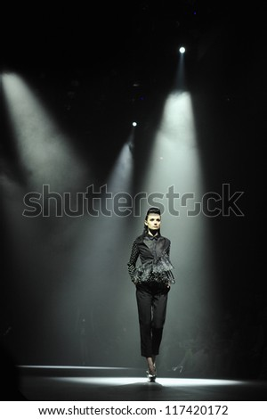 "BANGKOK, THAILAND - OCT 13 : Model walks the runway at "" Purinutt "" collection presentation during ELLE Fashion Week 2012 on October 13, 2012 in Bangkok Thailand."