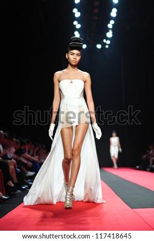 "BANGKOK, THAILAND - OCT 13 : Model walks the runway at "" Hooks "" collection presentation during ELLE Fashion Week 2012 on October 13, 2012 in Bangkok Thailand. - stock photo"