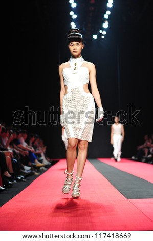 "BANGKOK, THAILAND - OCT 13 : Model walks the runway at "" Hooks "" collection presentation during ELLE Fashion Week 2012 on October 13, 2012 in Bangkok Thailand. - stock photo"