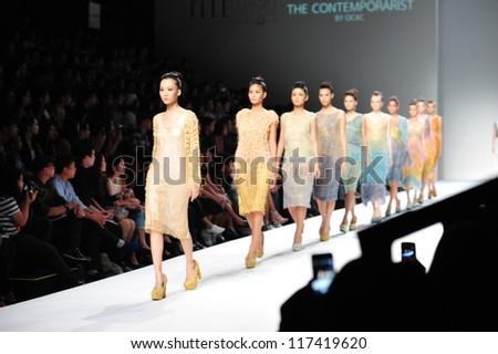 "BANGKOK, THAILAND - OCT 12 : Model walks the runway at "" OCAC "" collection presentation during ELLE Fashion Week 2012 on October 12, 2012 in Bangkok Thailand. - stock photo"