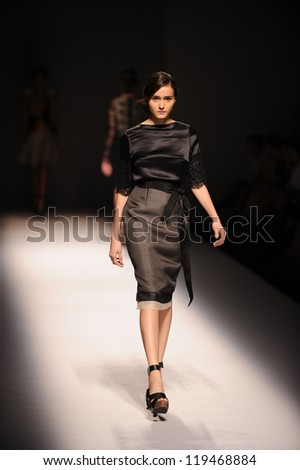 "BANGKOK, THAILAND - OCT 12 : Model walks the runway at "" VATIT ITTHI "" collection presentation during ELLE Fashion Week 2012 on October 12, 2012 in Bangkok Thailand. - stock photo"