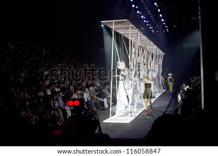 "BANGKOK, THAILAND - OCT 14 : Model walks the runway at "" Senada"" collection presentation during ELLE Fashion Week 2012 on October 14, 2012 in Bangkok Thailand."