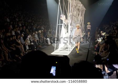 """BANGKOK, THAILAND - OCT 14 : Model walks the runway at """" Senada"""" collection presentation during ELLE Fashion Week 2012 on October 14, 2012 in Bangkok Thailand."""