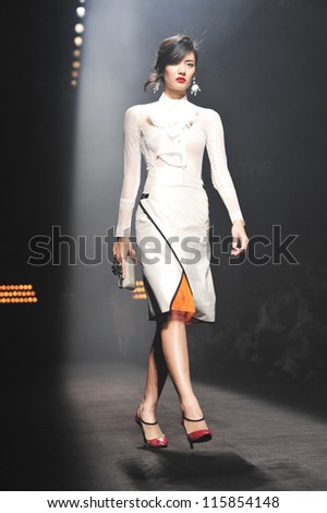 "BANGKOK, THAILAND - OCT 12 : Model walks the runway at "" Theatre "" collection presentation during ELLE Fashion Week 2012 on October 12, 2012 in Bangkok Thailand."