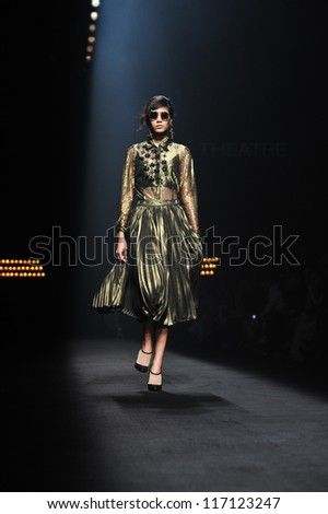 "BANGKOK, THAILAND - OCT 12 : Model walks the runway at "" Theatre "" collection presentation during ELLE Fashion Week 2012 on October 12, 2012 in Bangkok Thailand."