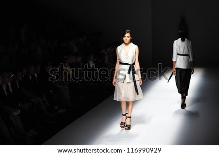 "BANGKOK, THAILAND - OCT 12 : Model walks the runway at "" Vatit Itthi "" collection presentation during ELLE Fashion Week 2012 on October 12, 2012 in Bangkok Thailand."