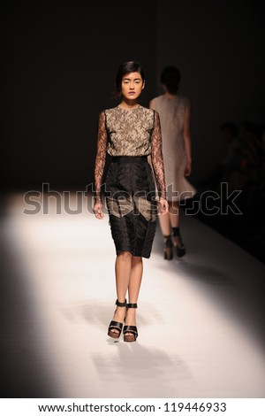 "BANGKOK, THAILAND - OCT 12 : Model walks the runway at "" VATIT ITTHI "" collection presentation during ELLE Fashion Week 2012 on October 12, 2012 in Bangkok Thailand."