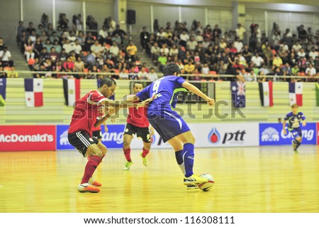 BANGKOK THAILAND - OCT 21 : Unidentified players in Friendly futsal match Between Thailand VS Egypt at Kiraves Stadium on October 21,2012 in Bangkok,Thailand. - stock photo