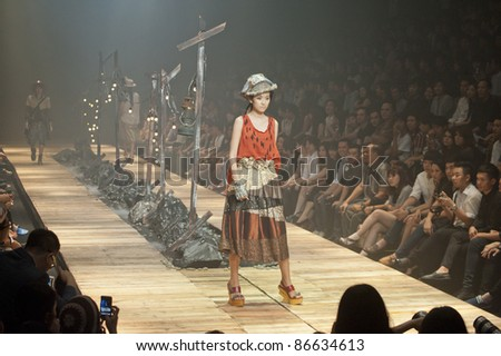 "BANGKOK, THAILAND - OCTOBER 13 : A model is walking the runway at "" 27 Friday "" collection presentation during ELLE Fashion Week 2011 Autumn/Winter on October 13, 2011 in Bangkok, Thailand."