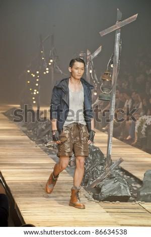 "BANGKOK, THAILAND - OCTOBER 13 : A model is walking the runway at "" 27 Friday "" collection presentation during ELLE Fashion Week 2011 Autumn/Winter on October 13, 2011 in Bangkok, Thailand. - stock photo"