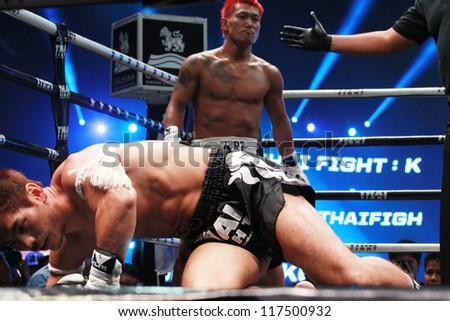 BANGKOK, THAILAND- OCTOBER 23 : Choi Woo Yeong (KOREA) vs  Nishikawa Tomoyuki (JAPAN) 70 KG.  in THAI FIGHT 2012. on October 23, 2012 at Chanchai Acadium, Bangkok, Thailand