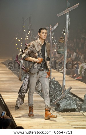 "BANGKOK, THAILAND - OCTOBER 13 : Model walks the runway at "" 27 Friday "" collection presentation during ELLE Fashion Week 2011 Autumn/Winter on October 13, 2011 in Bangkok Thailand."