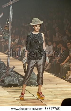 "BANGKOK, THAILAND - OCTOBER 13 : Model walks the runway at "" 27 Friday "" collection presentation during ELLE Fashion Week 2011 Autumn/Winter on October 13, 2011 in Bangkok Thailand."