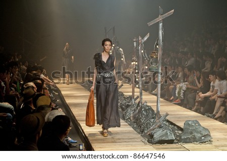 "BANGKOK, THAILAND - OCTOBER 13 : Model walks the runway at "" 27 Friday "" collection presentation during ELLE Fashion Week 2011 Autumn/Winter on October 13, 2011 in Bangkok Thailand. - stock photo"