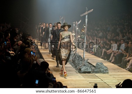 "BANGKOK, THAILAND - OCTOBER 13 : Models walk the runway at "" 27 Friday "" collection presentation during ELLE Fashion Week 2011 Autumn/Winter on October 13, 2011 in Bangkok Thailand."
