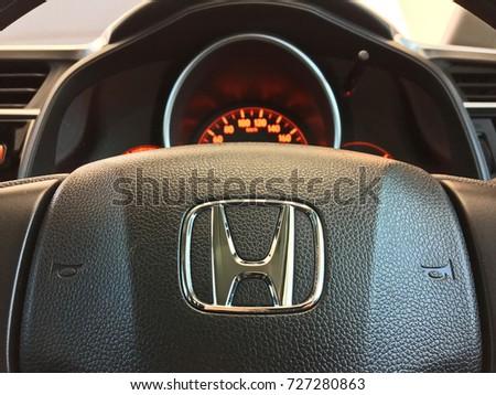 Bangkok, Thailand - October 1, 2017: Selected focus. Logo Honda on Black Steering Wheel and gauge, dashboard, instrument panel, speedometer.Honda is a Japanese automotive manufacturing company #727280863
