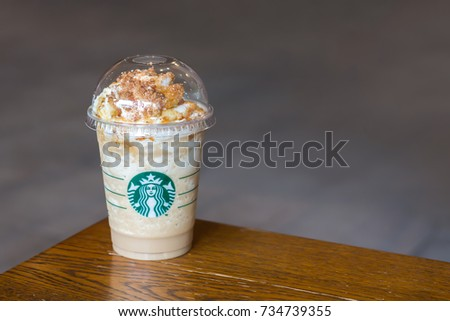 Bangkok, Thailand - October 13, 2017 : Starsbuck coffee sign, A glass of drink, Maple Pecan Latte Frappuccino. #734739355
