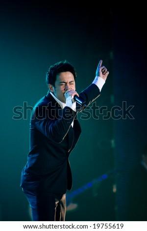 Bangkok, Thailand - October 25, 2008: Super Star TV Show Flukr Krirkpol singing at Super Star TV program.