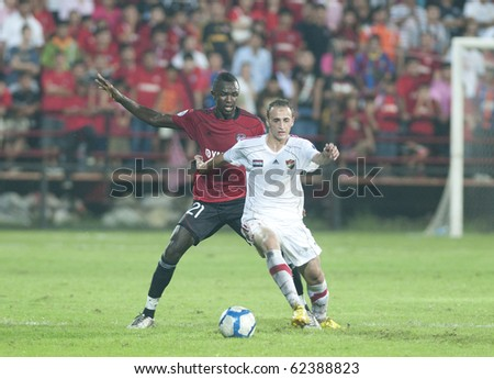 BANGKOK THAILAND- OCTOBER 5: T.Diab (L) fight Ball with S.Dagno (R) in AFC CUP between Muang Thong utd.(THA) vs AL Ittihad (SYR) on October 5 2010 in Thunderdome Stadium Bangkok Thailand - stock photo