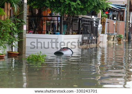 Bangkok, Thailand - October 3, 2015 : Water flood village in Don Mueang district. Problem with the drainage system. #330243701