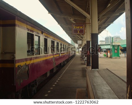 Bangkok, Thailand - Octorber 10, 2018 : Diesel locomotive train parked at Thonburi Railway Station in the afternoon waiting for passenger to board the train.  #1222763062