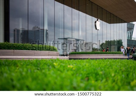 Bangkok, Thailand, Sep 8, 2019 - Apple Store at Icon Siam shopping mall with green garden in front ground #1500775322