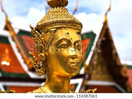 BANGKOK, THAILAND -SEP 07 : Golden statue of Kinnara at Wat Phra Kaew (officially known as Wat Phra Sri Rattana Satsadaram) in Grand Palace on September 07, 2012 in Bangkok, Thailand