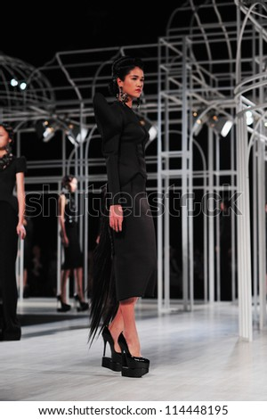 "BANGKOK, THAILAND - SEP 29 : Model walks the runway at "" Flynow "" collection presentation during Siam Paragon International Couture Fashion Week 2012 on September 29, 2012 in Bangkok Thailand."
