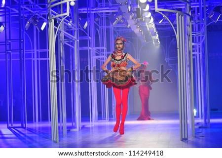 "BANGKOK, THAILAND - SEP 29 : Model walks the runway at "" Frederick Lee "" collection presentation during Siam Paragon International Couture Fashion Week 2012 on September 29, 2012 in Bangkok Thailand."