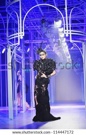 "BANGKOK, THAILAND - SEP 29 : Model walks the runway at ""Frederick Lee "" collection presentation during Siam Paragon International Couture Fashion Week 2012 on September 29, 2012 in Bangkok Thailand."