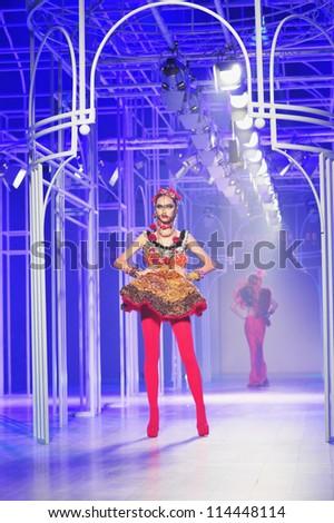 "BANGKOK, THAILAND - SEP 29 : Model walks the runway at "" Frederick Lee "" collection presentation during Siam Paragon International Couture Fashion Week 2012 on September 29, 2012 in Bangkok Thailand. - stock photo"