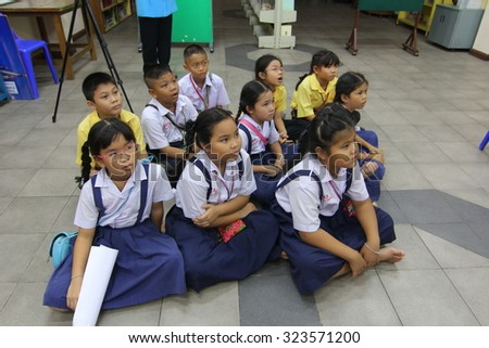BANGKOK, THAILAND - SEP 18, 2015: Unknown children in Academic Activities day at Elementary School. Pieamsuwan school, Bangkok Thailand, Teachers teach students with television.