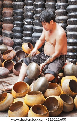 BANGKOK, THAILAND - SEPT 26:  An unidentified man make Bat (The alms bowl used by monks to receive donations of foods)  on September  26, 2011 at Ban Bat Community, Bangkok,Thailand.