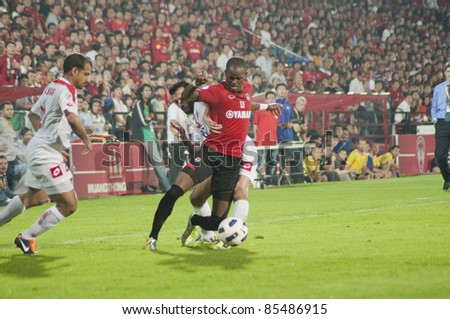 BANGKOK, THAILAND-SEPT 27 : K.Christian (R) of Muangthong United  in action during AFC Cup between  Muang Thong UTD(R) and Kuwait Fc(W) at Yamaha Stadium on September 27, 2011 in Bangkok, Thailand