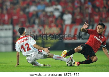 BANGKOK, THAILAND-SEPT 27: Nattaporn Panrit of  MTUTD in action during AFC Cup between Muang Thong UTD(R) and Kuwait Fc(W) at Yamaha Stadium on September 27, 2011 in Bangkok, Thailand