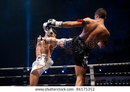 BANGKOK, THAILAND-SEPT 25: Unidentified fighters fight Muaythai at 'Thai Fight Muay Thai ...The World's Unrivaled Fight' at Thammasat University stadium on September 25, 2011 in Bangkok,Thailand - stock photo