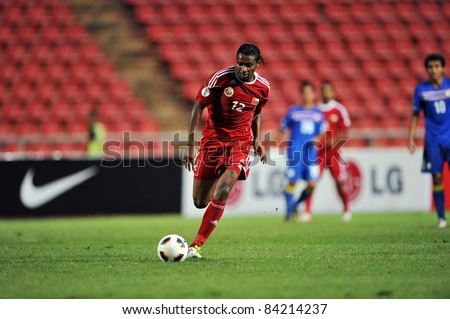 BANGKOK THAILAND - SEPTEMBER 6 : Ahmed of Oman in action during FIFA WORLD CUP 2014 (Round 3), between Thailand(B) and Oman(R) at Rajamangla Stadium on September 6, 2011  Bangkok, Thailand.