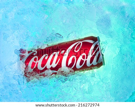 BANGKOK, THAILAND - SEPTEMBER 7, 2014: Can of Coca-Cola on ice. Coca-cola is one of the World\'s most popular carbonated soft drinks.