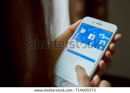 Bangkok, Thailand - September 13, 2017 : hand is pressing the Facebook screen on apple iphone6 ,Social media are used for information sharing and networking.