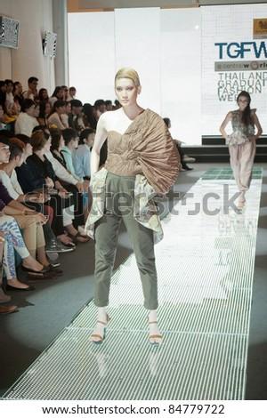 BANGKOK, THAILAND - SEPTEMBER 16 : Model showcases on the catwalk during Thailand Graduate Fashion Week 2011 on September 16, 2011 in Bangkok Thailand.