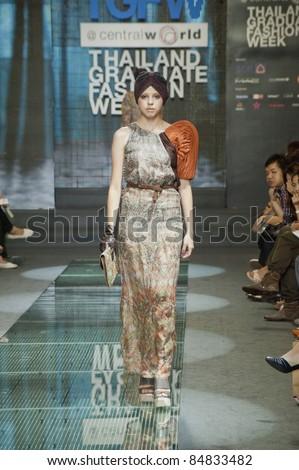 BANGKOK, THAILAND - SEPTEMBER 16 : Model showcases on the catwalk during Thailand Graduate Fashion Week 2011 ( TGFW )on September 16, 2011 in Bangkok Thailand.