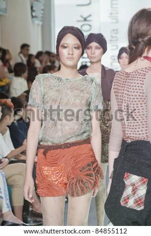 BANGKOK, THAILAND - SEPTEMBER 16 : Model showcases on the catwalk during Thailand Graduate Fashion Week 2011 ( TGFW ) on September 16, 2011 in Bangkok Thailand.