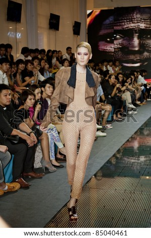 BANGKOK, THAILAND - SEPTEMBER 16 : Model walks on the catwalk during Thailand Graduate Fashion Week 2011 on September 16, 2011 in Bangkok Thailand.
