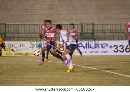 BANGKOK, THAILAND - SEPTEMBER 21 : P.Suwanchat (R) in action during Thai Premier League ( Divition 1) between BBCU Fc (P) vs Chainat fc (W) on September 21, 2011 at Army Stadium in Bangkok Thailand