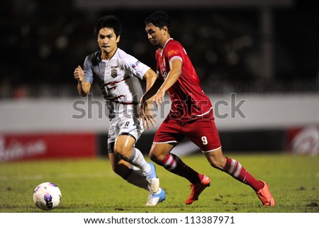 BANGKOK,THAILAND-SEPTEMBER1:Ronnachai Rangsiyo (red) of BEC Tero F.C.in action during Thai Premier League between BEC Tero F.C.and Insee Police Utd. at Thephasadin Stadium on Sep1,2012 in Thailand