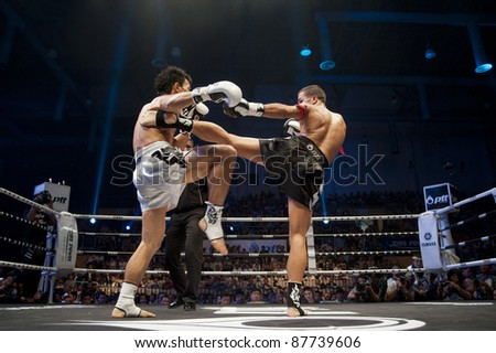 BANGKOK, THAILAND- SEPTEMBER 25 : Unidentified boxers compete in Thai Fight:Muay Thai World's Unrivaled Fight on September 25, 2011 at Thammasat University Convention Center in Bangkok, Thailand