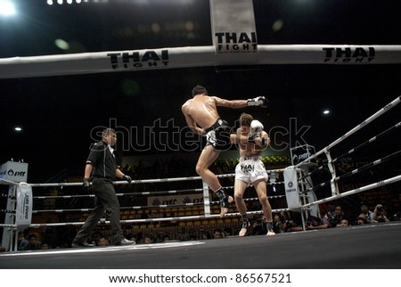 BANGKOK, THAILAND- SEPTEMBER 25 : Unidentified fighters in Thai Fight:Muay Thai. World's Unrivalled Fight on September 25, 2011 at Thammasat University Convention Center, Bangkok, Thailand