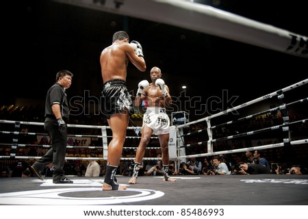 BANGKOK, THAILAND- SEPTEMBER 25 : Unidentified players in Thai Fight : Muay Thai. World's Unrivalled Fight on September 25, 2011 at Thammasat University Convention Center in Bangkok Thailand