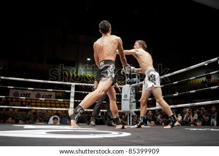 BANGKOK THAILAND- SEPTEMBER 25 : Unidentified players in Thai Fight : Muay Thai..World's Unrivalled Fight on September 25, 2011 at Thammasat University Cnvention Center,Bangkok Thailand